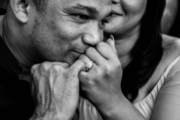 grayscale photo of woman putting her hand on her face